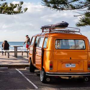 orange van by water