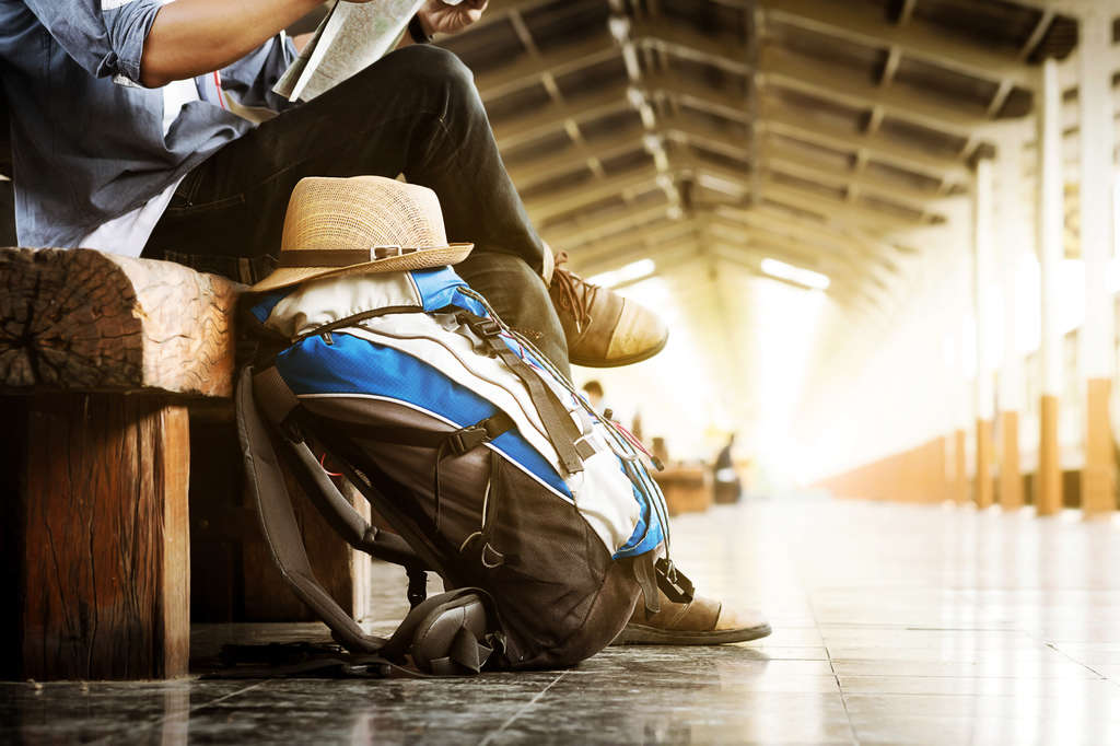 Travel backpack next to man in train station