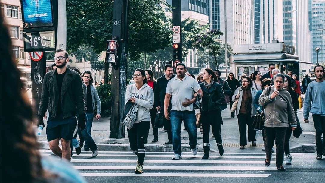 pedestrians walking across the street
