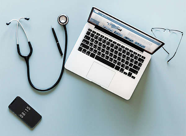 laptop, stethoscope, glasses, phone