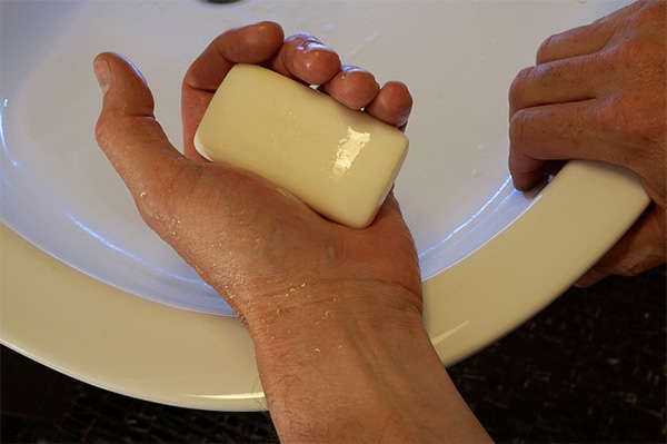 man holding bar soap
