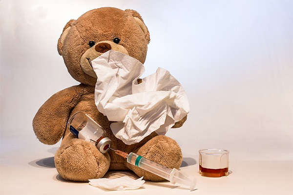 teddy bear with tissue and vaccine