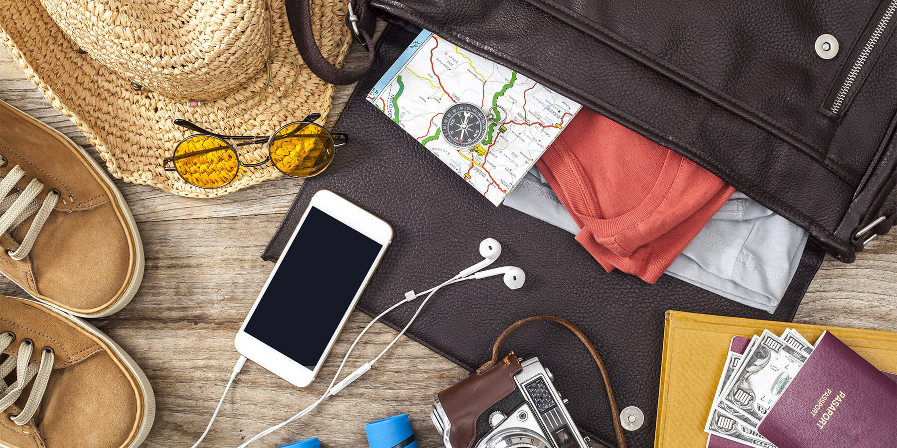 Travel Accessrories Laid out on Wooden Table